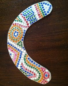 Imagine you're an aborigine from Australia by creating a painted boomerang made out of cardboard!