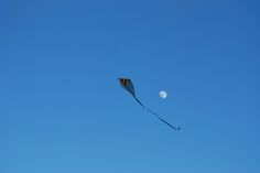 A kite dancing with the moon, above Stavanger...