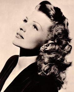 "Hairstyles That Defined an Era | InStyle.com Usually when ""Old Hollywood glamour"" is used as style inspiration, the coiff of choice is similar to the Rita Hayworth's defined loose curls. The star's cascading texture made waves in the beauty world throughout the '40s and '50s, and has recently experienced a revival with the celebrities of today."