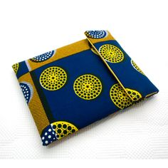 A simple yet bold iPad sleeve. Make a statement with this colourful and fun alternative to a regular iPad sleeve. This Africa-inspired piece is made in a bright blue and yellow fabric from Nigeria known as 'Ankara'. #African #Ankara #Handmade