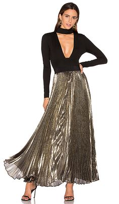 Shop for Alice + Olivia Katz Pleated Maxi Skirt in Gold & Black at REVOLVE. Free 2-3 day shipping and returns, 30 day price match guarantee.