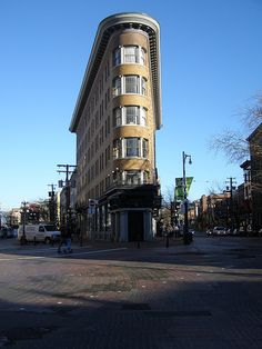 """Hotel Europe, a """"Flatiron"""" Building in the Gastown district of Vancouver, B.C. -  Built in 1909.  It is no longer a hotel as in 1983 it was converted into affordable housing units. This was the first reinforced concrete structure to be built in Canada and the earliest fireproof hotel in Western Canada."""