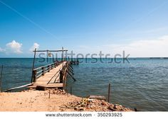 City Rameswaram, Tamil Nadu, South India. Bay of Bengal, the wooden pier for boats - stock photo