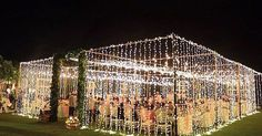 Temporary outside room created with fairy lights with floral or foliage entrance. Perfect for an evening blessing. | Wedding ideas | Pinterest | Dance floors,…