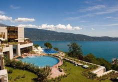 An award-winning, five-star resort overlooking Italy's beautiful Lake Garda, with spa access and other perks