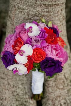Love the orchids in this bold bouquet! Shot by frenzelphotographers.com