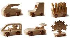 Aw, these are wonderful. One hundred different architects and designers have each put their own creative spin on a small wooden car for 100% ToBeUs, a traveling exhibition of super minimal mini-roadsters.