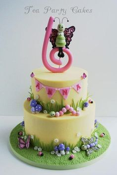 Spring themed cake made for a little girl's 6th birthday. 6 and 8 inch buttercream covered cakes with fondant details. This cake brought some much needed spring to me as we're still experiencing snow and cold. TFL!