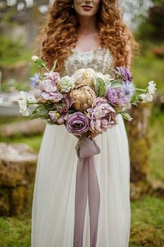 Dusty-purple bridal bouquet   Photo by Your Adventure Wedding
