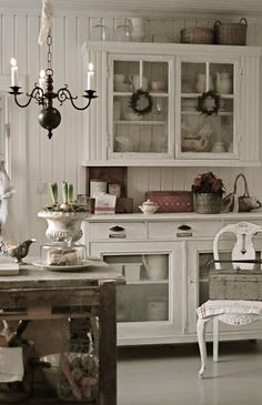 Beautiful cottage kitchen:  I'd love to have a hutch similar to this setup with a cabinet above and buffet underneath.
