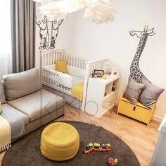 Beautiful nursery decor by Kiklos Architecture Agency with some large E-Glue jungle animals wall decals : giraffe, elephant, lion wall stickers that matched the color trendy scheme.