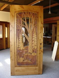 "Custom - Trost3'-6"" x 7'-6"" Alder door with sandcarved design (both sides) & glass - 2 1/4"" thick. Cost (w/jamb) . . . $6,425 (plus shipping)"
