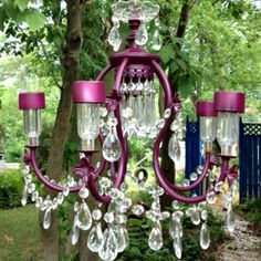 """Recycled chandelier adding solar lights. This one was made for me! I have all the """"crystal"""" just need an old chandelier or ten.. haha"""