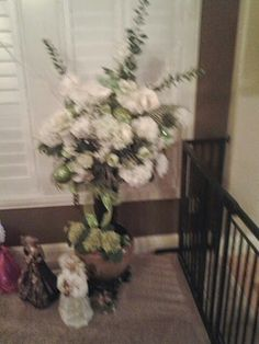 White and lime green flower arrangement