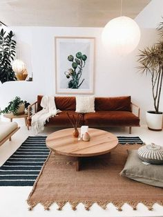 Layered rugs, white walls, coffee table, plants. Casual with a hint of glam/sophistication