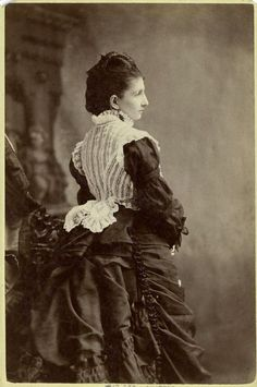 Woman standing with her back turned 1870s
