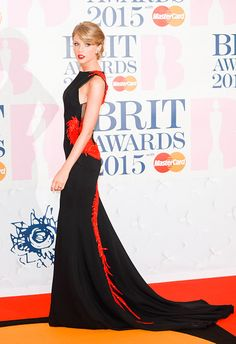 In Roberto Cavalli Atelier at the 2015 BRIT Awards in London. See Taylor Swift's full fashion evolution, from sequins in 2007 to her many crop tops today.