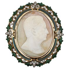 1890s Shell Cameo Enamel Diamond Gold Brooch. An important shell cameo stylizing a man's face surrounded by green enamel and old cut diamonds on 18 k gold brooch. Circa 1890.