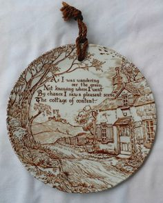 This brown and white Crownford China plate has a lovely painted scene of an English countryside with a quaint cottage on it. The poem on the front reads  As I was wandering oer the green not knowing where I went by chance I saw a pleasant scene the cottage of content . The back is stamped Crownford China Co. Inc Staffordshire England.