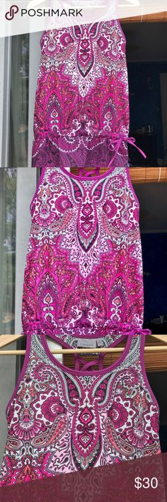 ATHLETA YOGA/FITNESS TOP PAISLEY DESIGN SMALL ATHLETA YOGA/FITNESS TANK PAISLEY DESIGN SIZE SMALL EXCELLENT CONDITION! THE TANK HAS BUILT IN BRA BUT NOT PADDED, TIE ON THE SIDE OF WAIST AND ELASTIC AT WAIST. NICE DESIGN ON BACK. Athleta Tops Tank Tops
