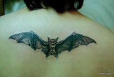 Flying Bat Tattoo On Upper Back