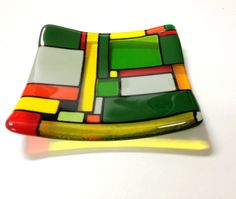 This will go in any entrance hall - your boardroom table - your dining table - where can you imagine this bright red green yellow and orange art glass platter? To make ordering and re-ordering easy, each one of my works has been give a special name, this one is called: ARIZONA.  It is a truly unique gift.  I wrote a blog about my glass pieces and my studio : http://jenieyolland.com  Each Jenie Yolland original artwork is hand-crafted one at a time by me. All efforts are made to produce works…