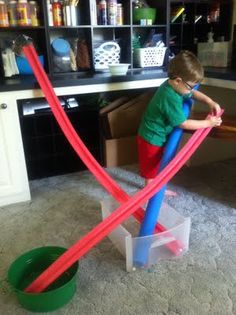 Pool noodles cut in half for marble runs