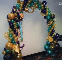 Mardi Gras Balloons Decorations Arch | Cluster Arch with modeling balloon to give the Caribbean Feel