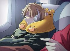 England. On a plane, sleeping. With an adorable neck pillow...Even when he's asleep he's scowling! How cute! *fangirl squeal/giggle (if I'm being honest here)*