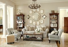 Warm living room featuring a gallery wall and layered tones