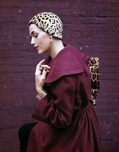 Georgia Hamilton poses in a plum-colored coat and jaguar hat designed by Pauline Trigere, photo by Genevieve Naylor, 1949