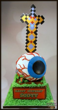 Terraria cake with the Eye of Cthulu and Excalibur