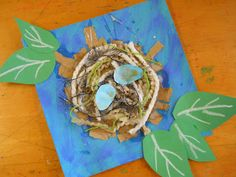 like the mixed media nest, nix the leaves and make 3-D eggs from paper... maybe even make our own marbled blue paper, smushed into and egg shape, let dry and put in our nest?