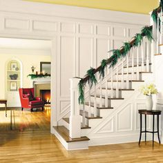 Adding even a simple garland to a front hall banister can make the whole room look sophisticated.