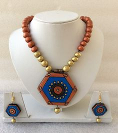 Copper geometric designer wear #terracotta #necklaceset with 33% discount at #craftshopsindia