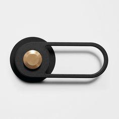 PL-OS No. 01 Pilule Light Door Handle in black powder coated metal and satin brushed brass
