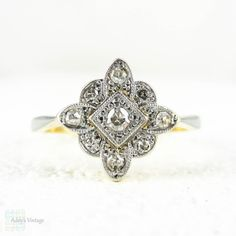 Gorgeous Art Deco diamond engagement ring. Nine diamonds are bead set in a square shaped top with the square turned on its point like a diamond. The centre