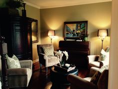 Client living room with four chairs and ottoman