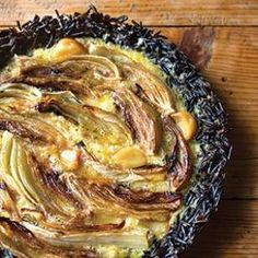 Wild rice bound with egg and cheese makes a lovely (and gluten-free) crust for this stunning, quiche-like pie stuffed with roasted garlic and fennel.
