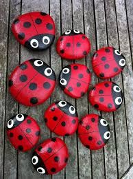ladybird pebbles - cute idea to place a couple on the soil inside a flower pot or glue to the pot. make a ladybug stepping stone.press the ladybugs in soft concrete.