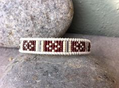 This bracelet is designed with Miyuki delica11/0 seed beads in expresso bean and vanilla and accented with silver bugle beads. Wrap is woven on