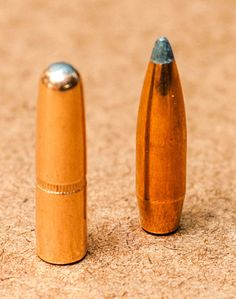 Round nose bullets have greater sectional density than spitzers. In the picture, the 220-grain round nose bullet is the same length as the 180-grain boat tail spitzer pictured.