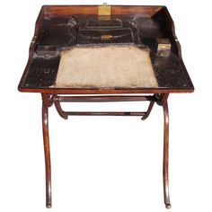 English mahogany folding campaign desk with fitted leather interior consisting of document pouch,original ink well, quill box, writing surface, and terminating on supported x framed legs. Folding Furniture, Antique Furniture, Modern Furniture, Campaign Desk, Campaign Furniture, British Traditions, Sideboard Cabinet, Home Comforts