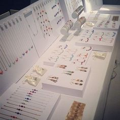 Clean and organized jewelry display on a craft show table