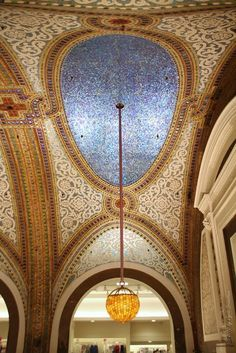Tiffany stained glass vaulted ceiling in Marshall Fields now Macy's.