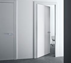 Invisible hinges. Contemporary door trim. Bella! Lualdi Door, Milan, Italy - Filo 55. (Click on photo for larger image.) Photo found here: http://www.lualdi.com/IT/Prodotti.aspx#porte|filo_55