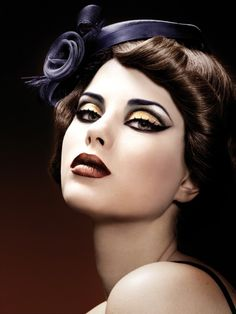 For the perfect steam punk look for Halloween: take a bronze, or copper- even gold eye shadow and out line it with black eye liner. And a dark red lip to make the steam punk look perfect!!