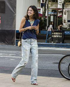 oh awesome! Leandra kickin around in some fab destroyed  denim in NYC. #LeandraMedine #ManRepeller