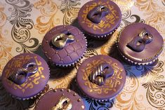 Venetian Mask Cupcakes by Victoria's Kitchen, via Flickr