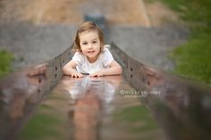 climbing up a slide - Toddler Portrait | Mikki Skinner Photography